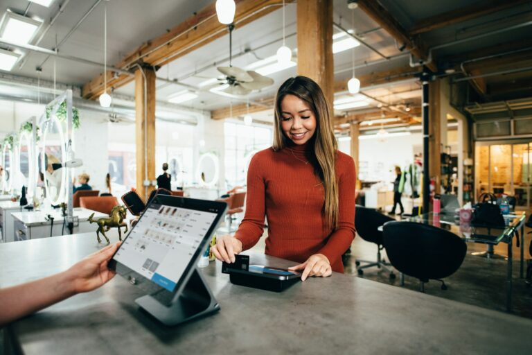 Woman at a checkout in a restaurant