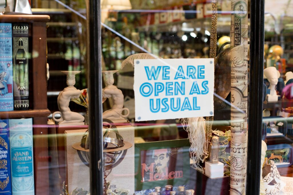 we are open sign in shop window